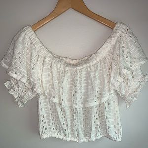 Off the shoulder white Free People top.